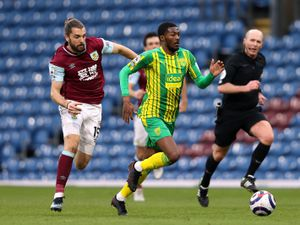 """West Bromwich Albion's Ainsley Maitland-Niles and Burnley   s Jay Rodriguez (left) battle for the ball during the Premier League match at Turf Moor, Burnley. Picture date: Saturday February 20, 2021. PA Photo. See PA story SOCCER Burnley. Photo credit should read: Clive Brunskill/PA Wire.    RESTRICTIONS: EDITORIAL USE ONLY No use with unauthorised audio, video,  data, fixture lists, club/league logos or """"live"""" services. Online in-match use limited to 120 images, no video emulation. No use in betting, games or single club/league/player publications."""