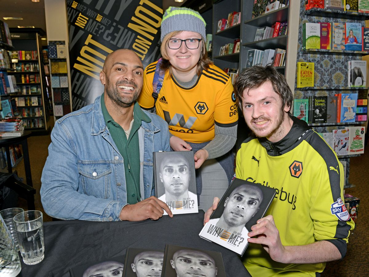 Former Wolves Keeper Carl Ikeme pictured with Niamh Lewis from Bilston and Dan Bird from Willenhall as he signs copies of his new book 'Why Not Me' at Waterstones in Wolverhampton