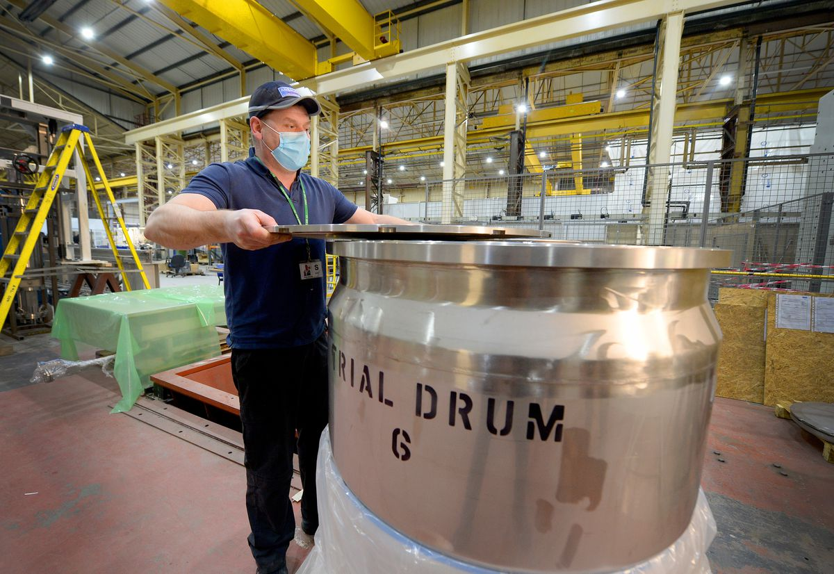 Cell leader Pete Andrews inspects one of the isolation drums