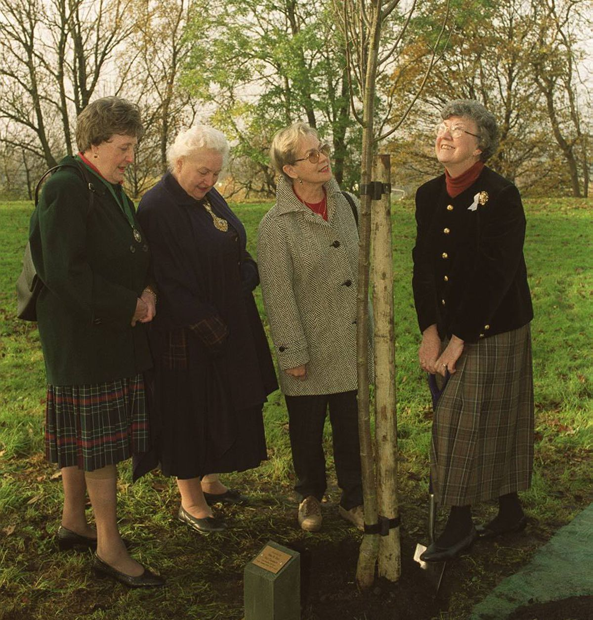 National chairman Marjory Hall plants a tree in Marsh Park, Brierley Hill watched by, Jean Darby, chairman of Brierley Hill TWG, Mavis hunt, Mayoress of Dudley and Margaret Tew, chairman of the West Midlands federation of TWG in 1999