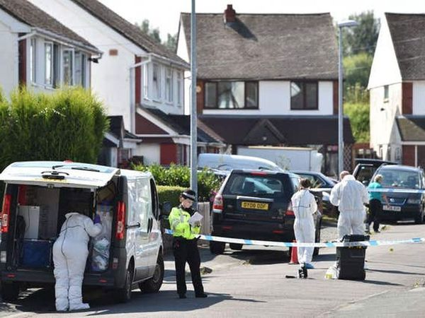 Forensic teams at the scene in Meadow Close, Telford, in August 2016
