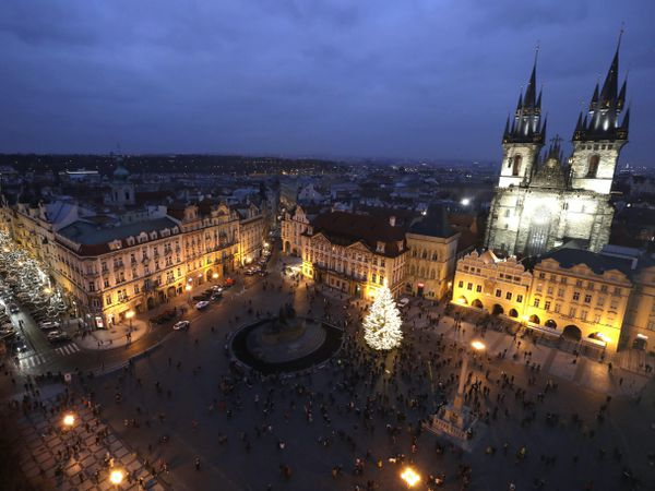 A Christmas tree illuminates the Old Town Square in Prague