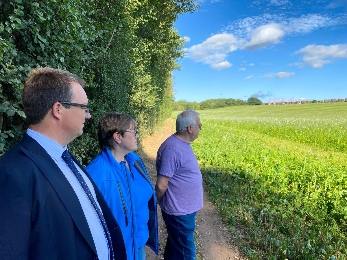 Mike Wood MP with members of the Wall Heath As One campaign group at an under threat site