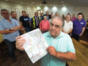 Bill Wilkinson, with a copy of the Velo Birmingham road closure information, at The Wine House in Halfpenny Green