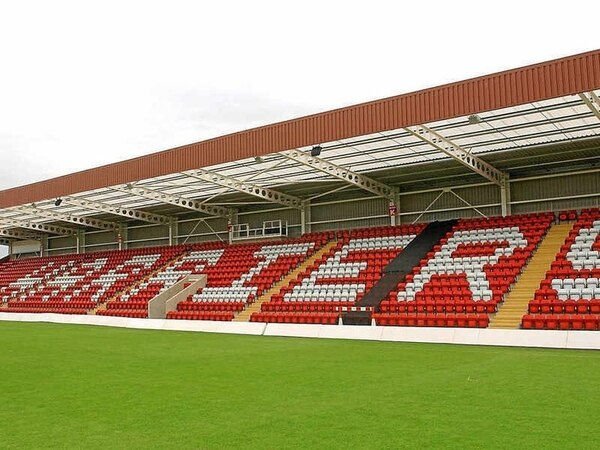 Kidderminster Harriers sold to group led by son of late club director