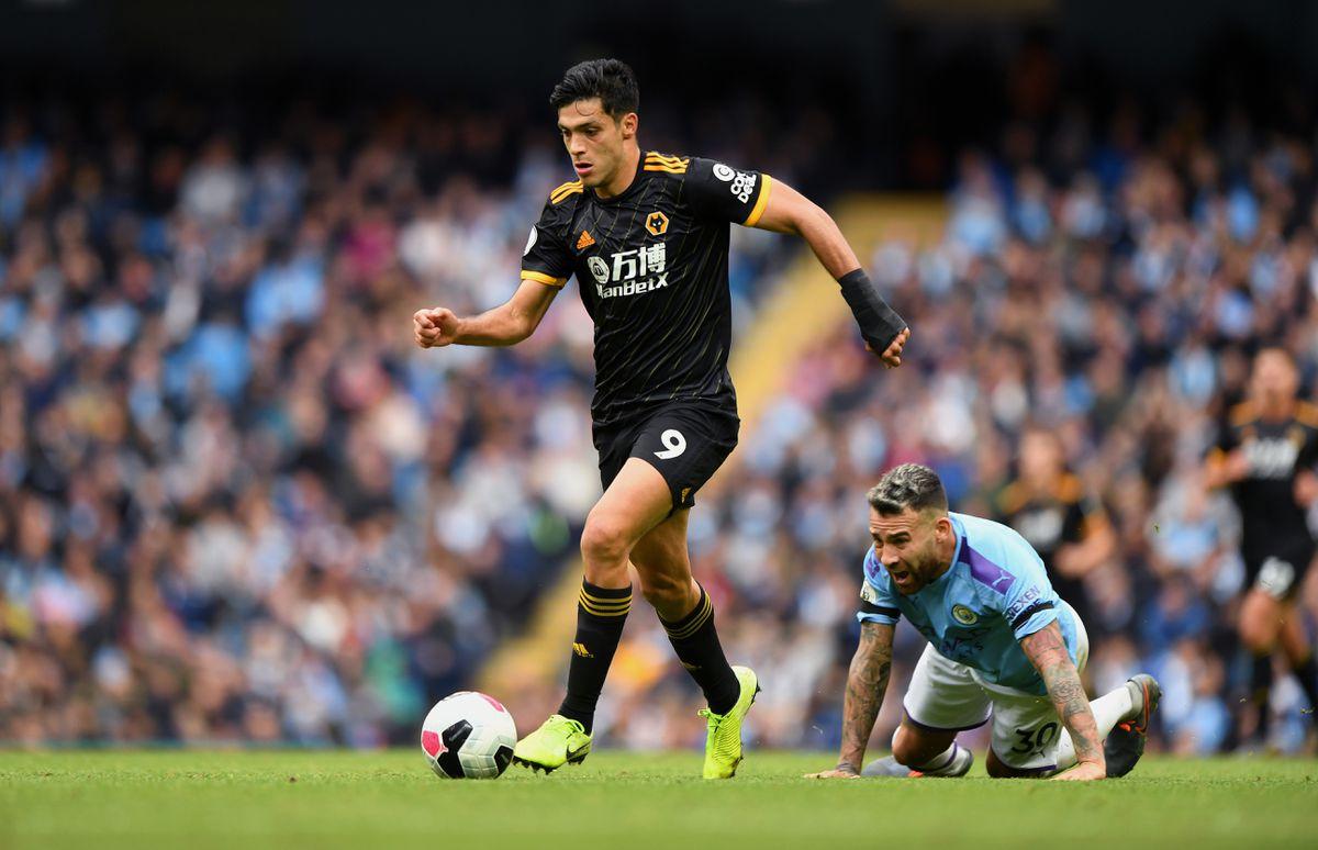Raul Jimenez of Wolverhampton Wanderers and Nicolas Otamendi of Manchester City. (AMA/Sam Bagnall)