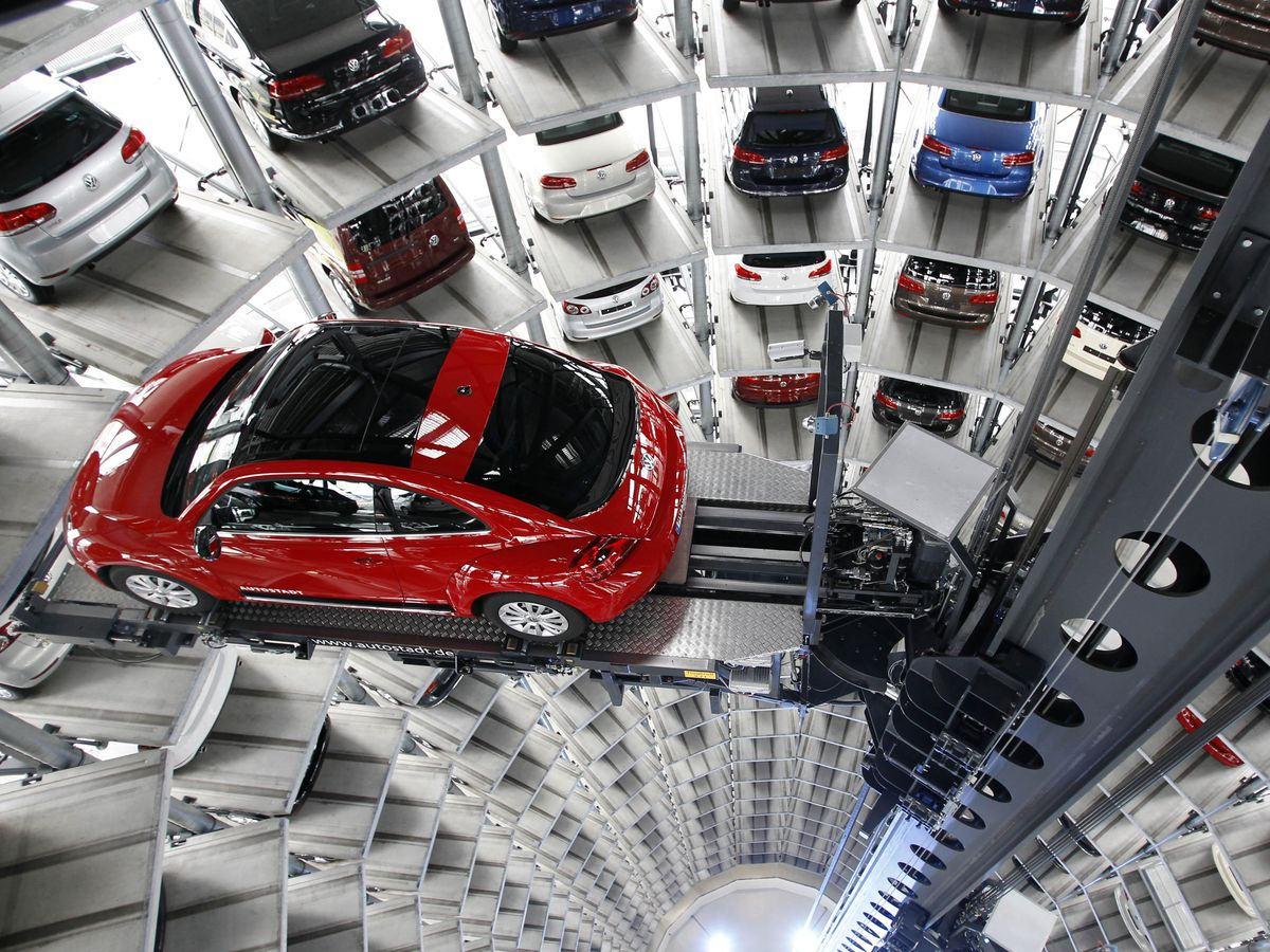 FILE - In this March 12, 2012 file picture a  Volkswagen New Beetle car is lifted inside a delivery tower  in Wolfsburg, Germany.  German automaker Volkswagen AG says its 2012 group sales hit a record high as growing demand around the world more than offset sluggish sales in Europe. It says Monday Jan. 14, 2013  that more than nine million vehicles were delivered for the first time. The total of 9.07 million was up 11.2 percent from the 8.16 million delivered in 2011. (AP Photo/Michael Sohn,File)