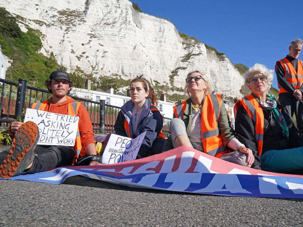 Protesters from Insulate Britain block the A20 in Kent, which provides access to the Port of Dover in Kent. The environmental activists have moved location after been banned from campaigning on the M25 motorway in London. Picture date: Friday September 24, 2021. PA Photo. See PA story POLICE Insulate. Photo credit should read: Gareth Fuller/PA Wire