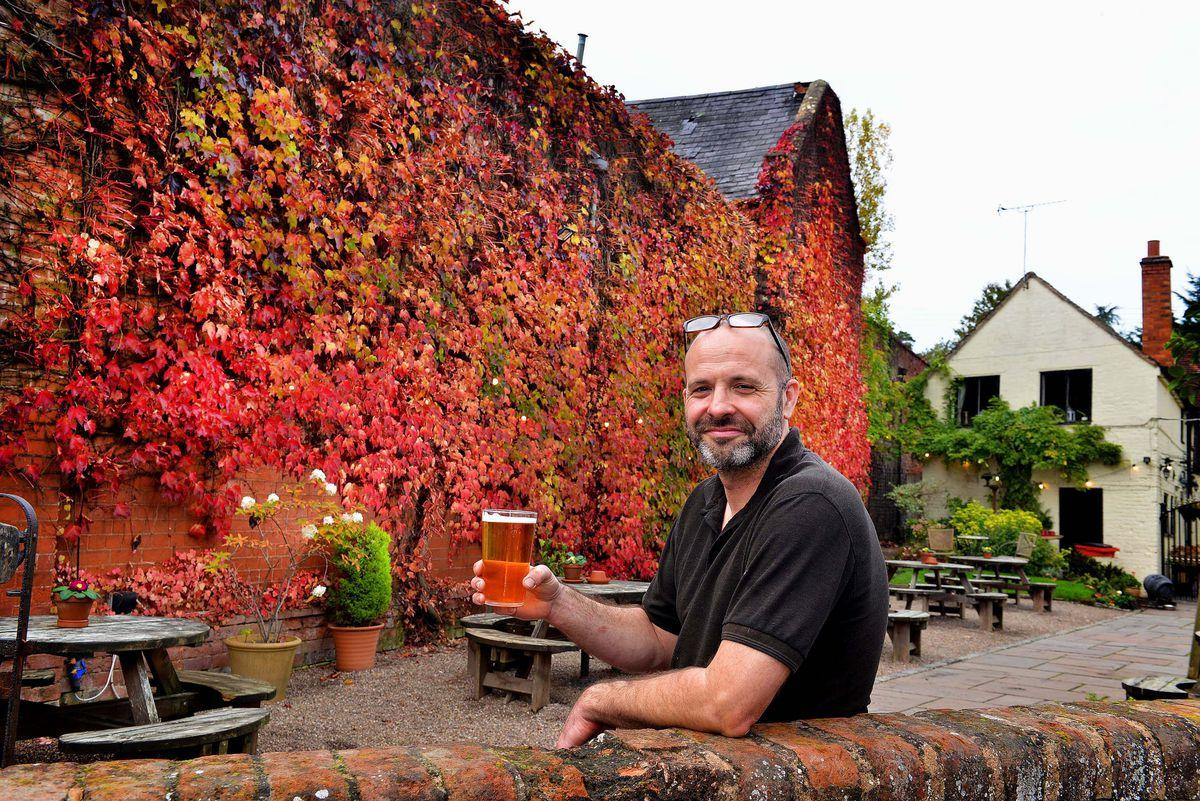 Dan Hicks in the Cat Inn's colourful beer garden