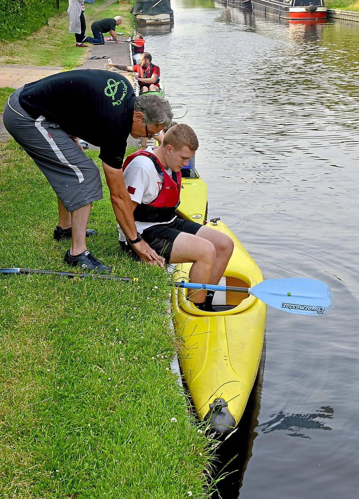 Express & Star reporter Jamie Brassington is shown how to get into a canoe correctly by Bankside coach Nigel Hargrave at Gailey Canoeing Club, Croft Lane, Gailey, Penkridge.