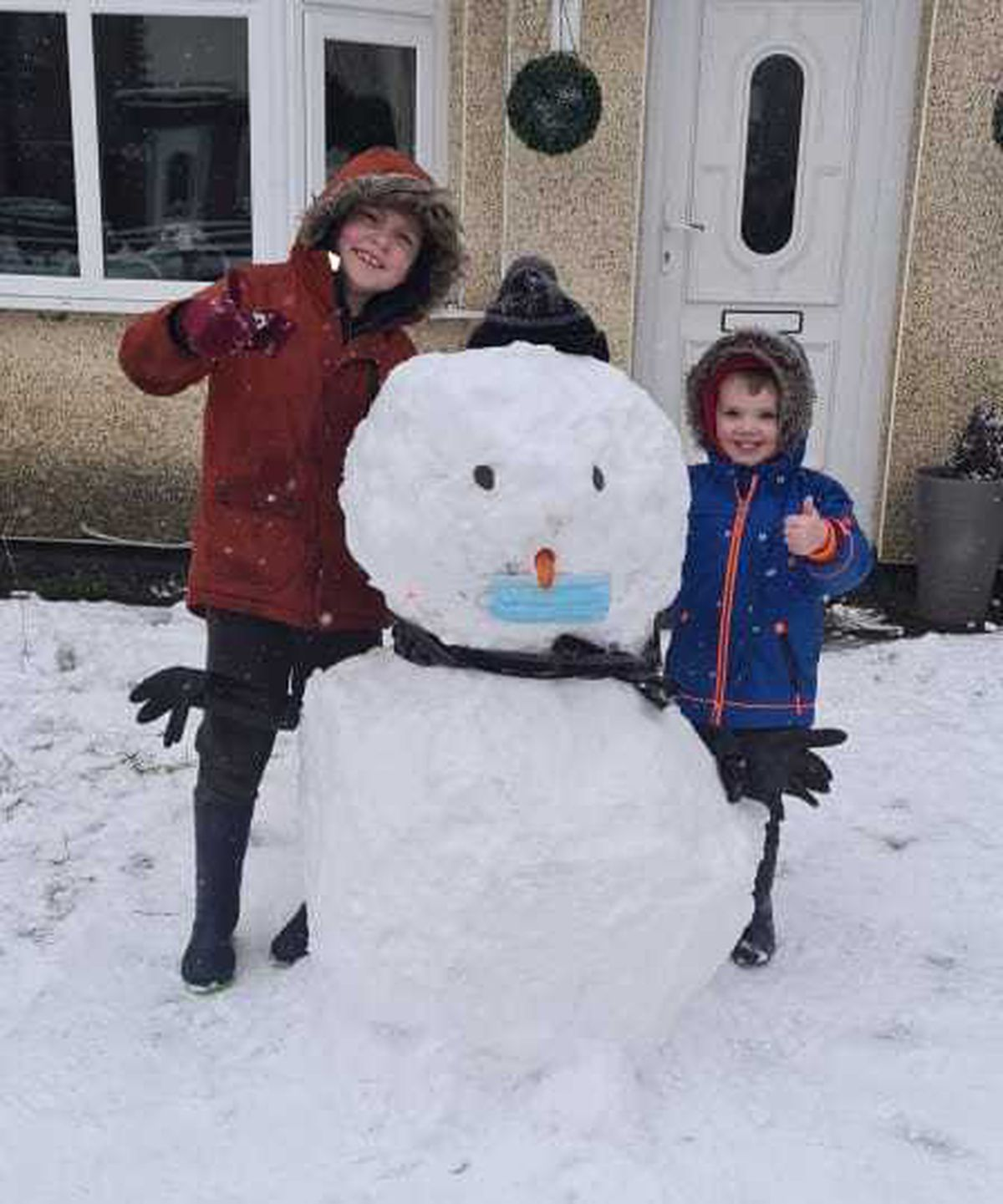Leah Andrew took this photo of her boy's enjoying the snow after a period of self-isolation due to Covid-19.