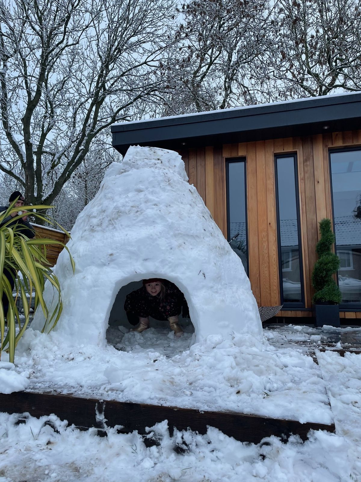 Kirsty Evans took this picture at her home in Westcroft in south Staffordshire of her daughter inside a giant igloo