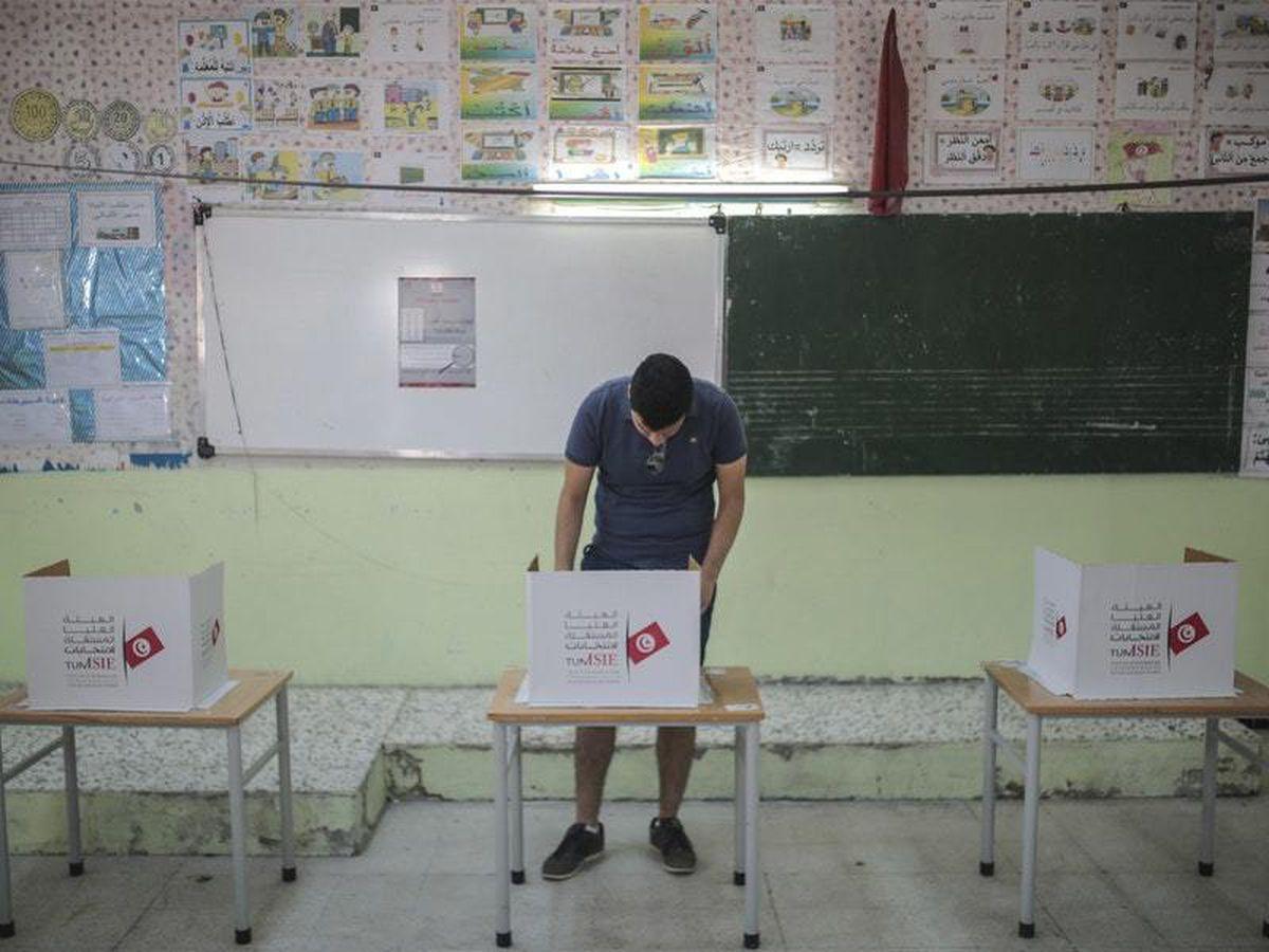 A voter casts his ballot