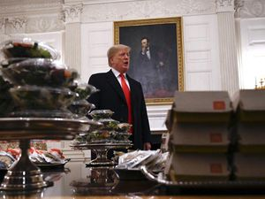 Donald Trump talks to the press about the table of food in front of him
