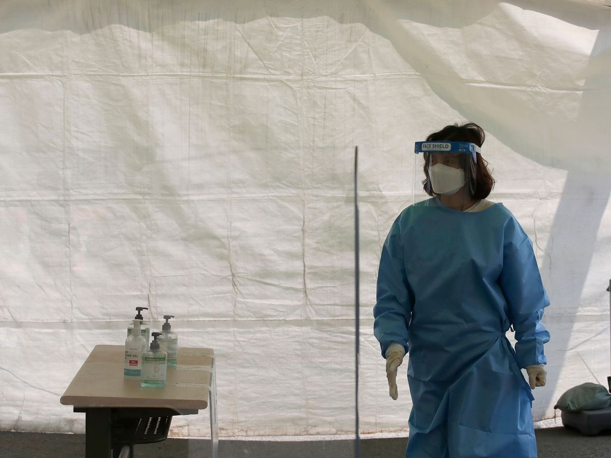 A health official at a coronavirus clinic in Seoul, South Korea