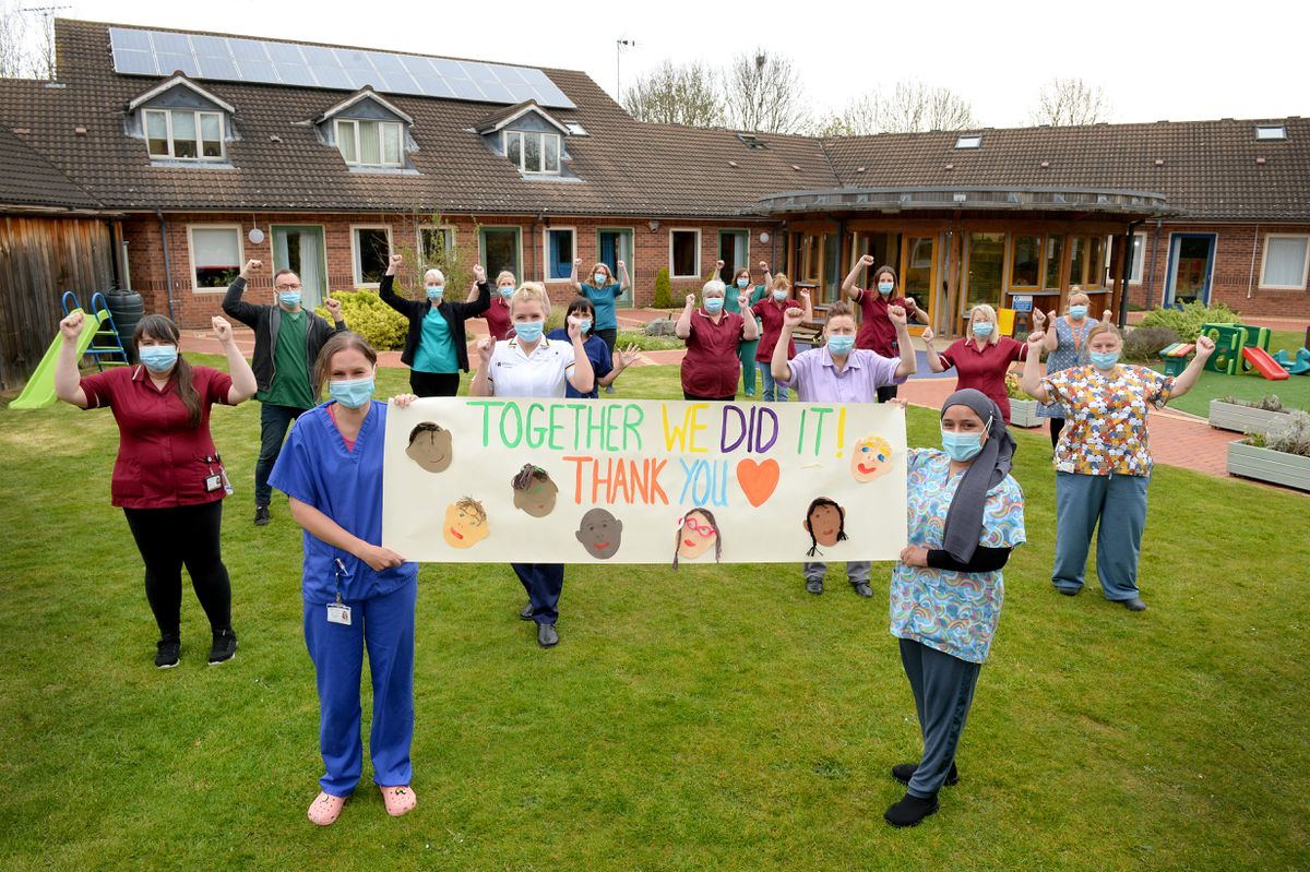 Staff members at Acorns Children's Hospice in Walsall celebrate after the hospice was saved from the threat of closure.