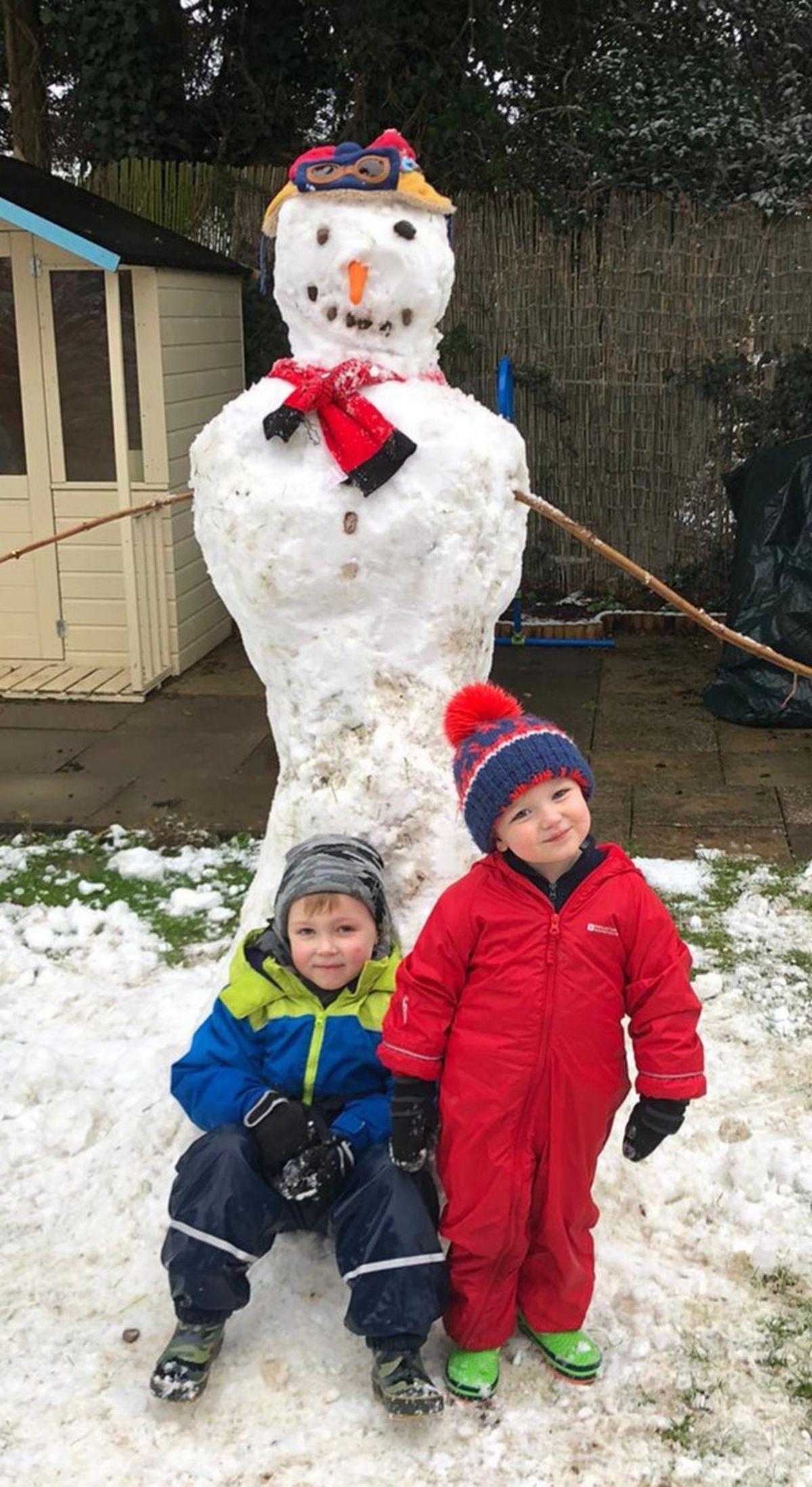 Zach and Joel Burgess enjoying the snow. Photo: Grandma Gill in Little Haywood