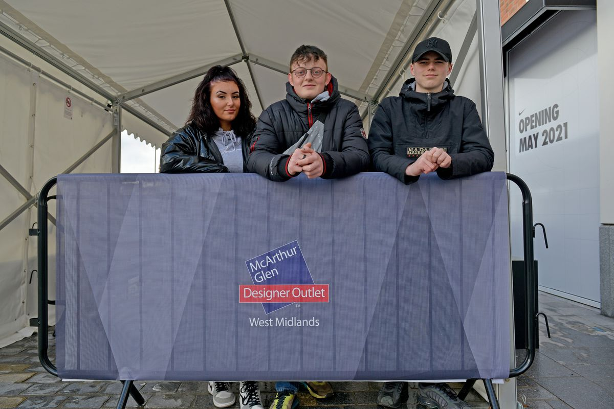 The McArthur Glen designer outlet opens in Cannock. Pictured, first in the queue: Olivia Hopton, Samuel Cooper and Harry Cantaill