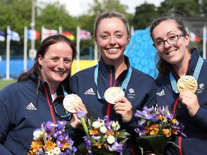 Archers Naomi Folkard (left), Bryony Pitman (centre) and Sarah Bettles (right) celebrate with their medals after winning gold in the Women's Archery Recurve Team event, during day two of the European Games 2019 in Minsk..