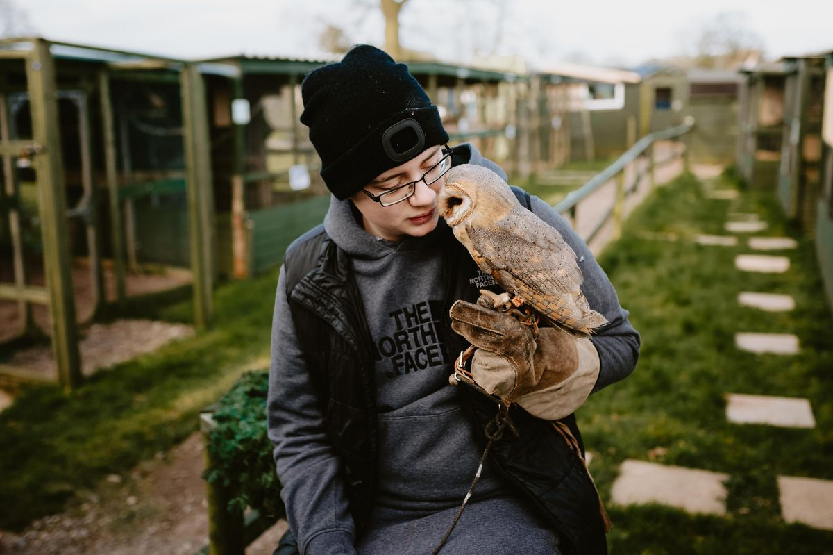 Jack Smith, a volunteer at the sanctuary, and Thane, a dark breasted barn owl