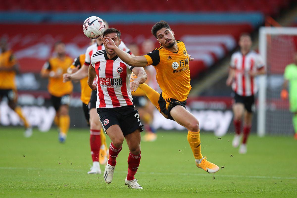 George Baldock of Sheffield United and Pedro Neto of Wolverhampton Wanderers (AMA)