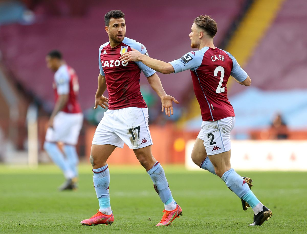 Aston Villa's Trezeguet (left) celebrates scoring their side's first goal of the game