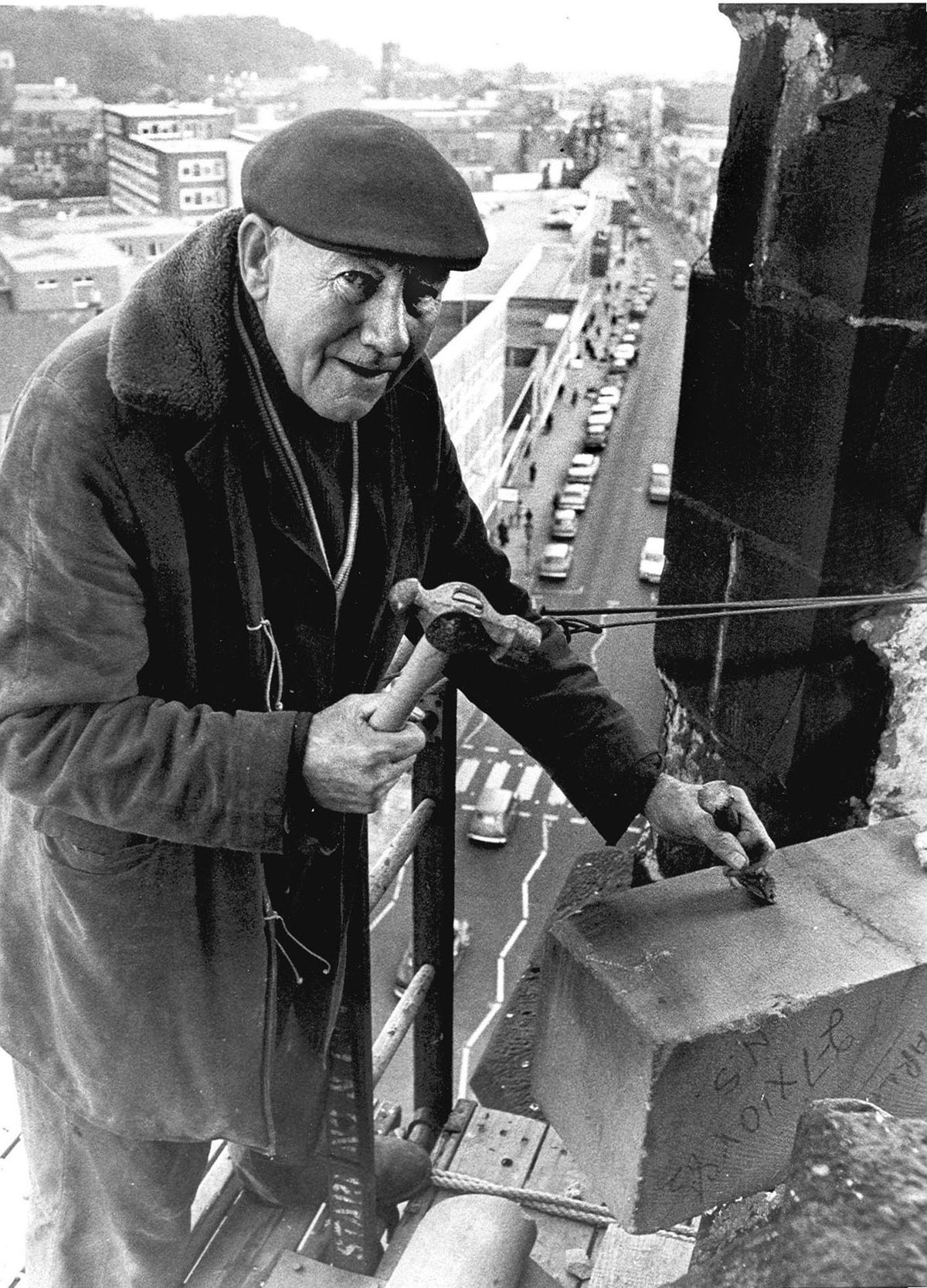 Les Dunn (68) is doing a job that would terrify most of us. Steeplejack Les, who was  repairing the stonework on St Thomas Church, Dudley, Worcs in 1975  was working 175 ft above the main street.