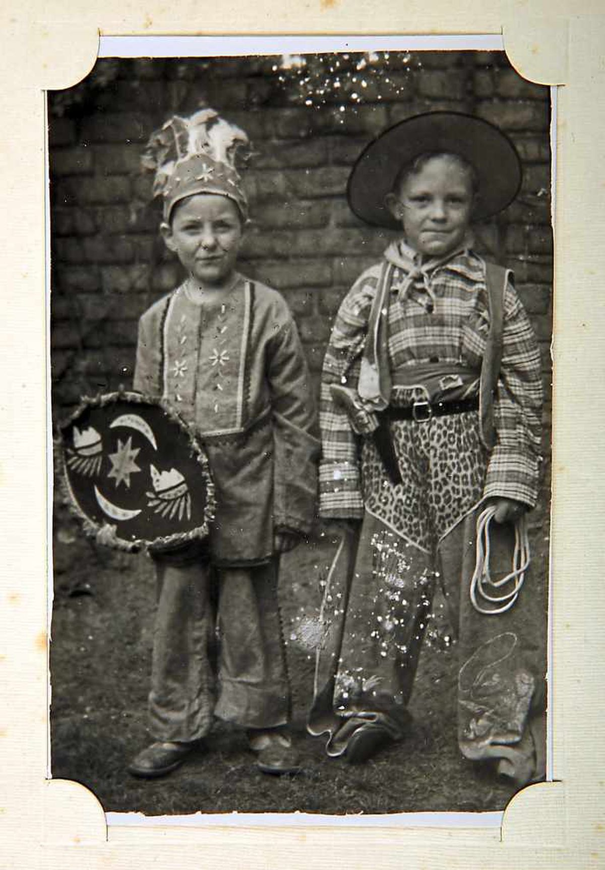A young Eric playing at dressing up in the late 1940s