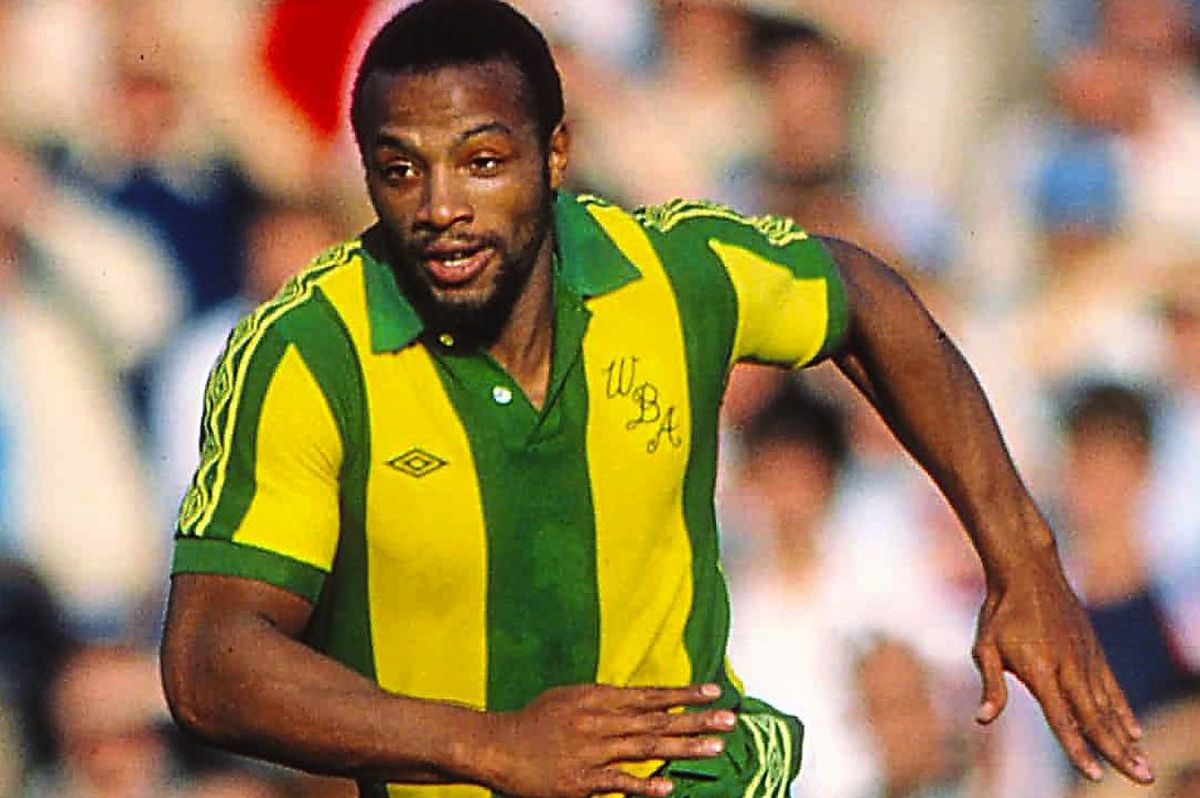 Cyrille Regis in the iconic shirt the kit is tailored on.