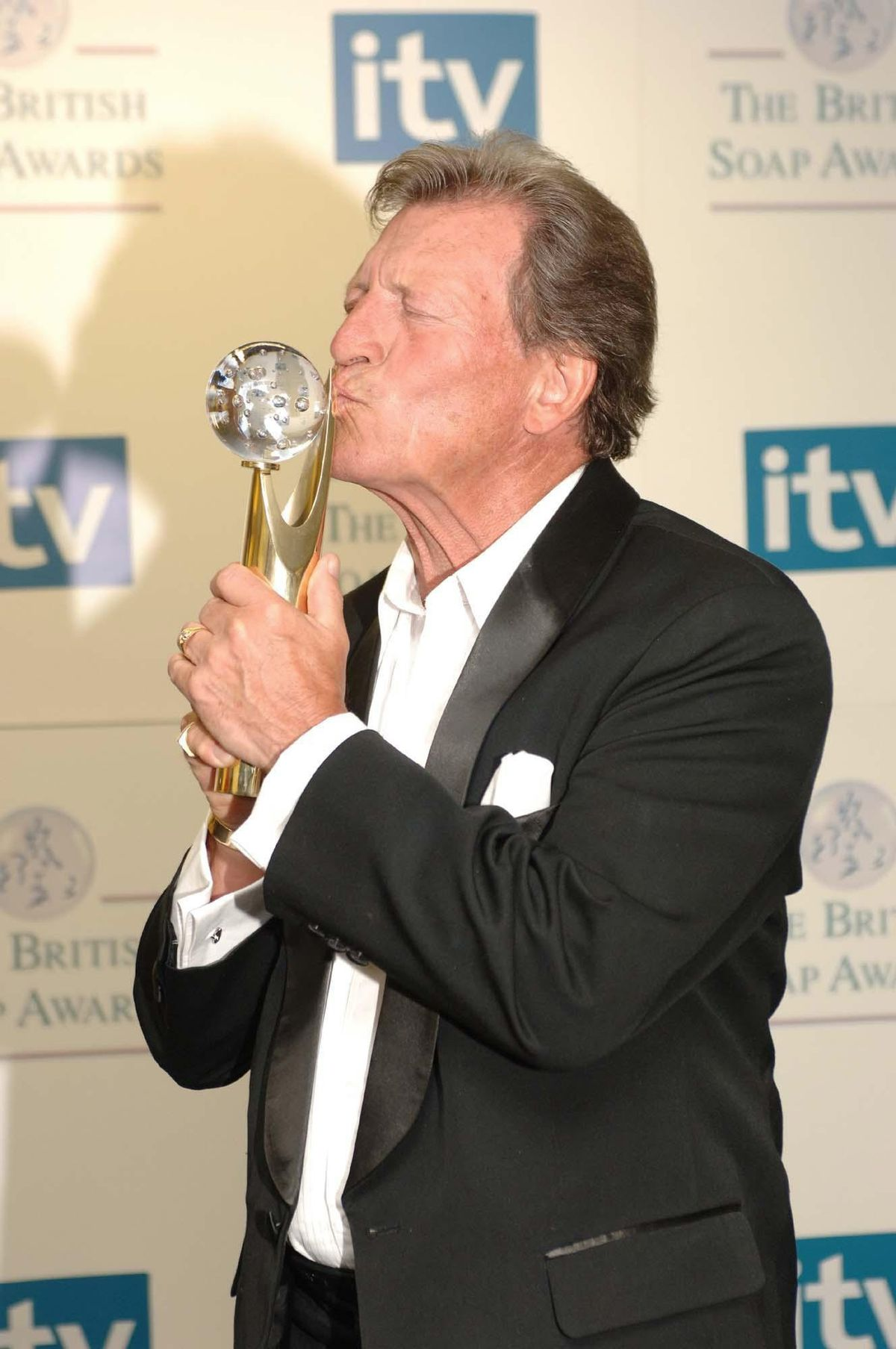 Johnny Briggs with his Lifetime Achievement award at the British Soap Awards, in 2006. Photo: Fiona Hanson/PA Wire.