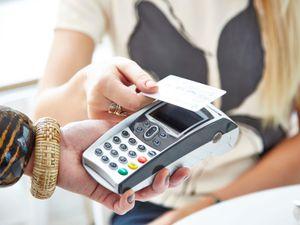 A shopper makes a contactless payment