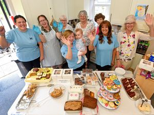 Staff and volunteers celebrate the reopening of the MS Therapy Centre, Tettenhall, including centre manager Paula Anderson holding her eight month old grandaughter Ruby Lou Homer
