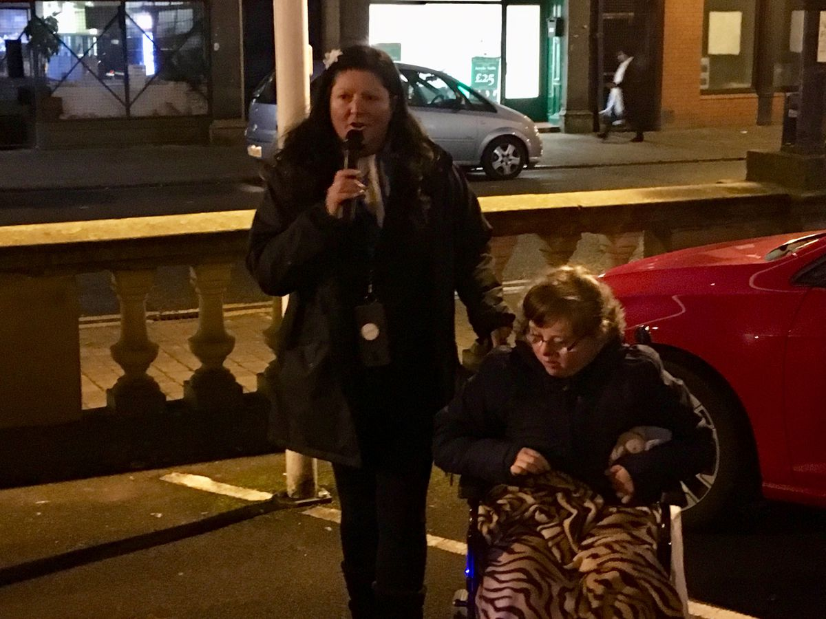 Jo Yarnall, with her daughter Hannah, speaks to protesters outside Walsall Council house about proposed cuts to the Home to School Transport scheme. Pic by Gurdip Thandi