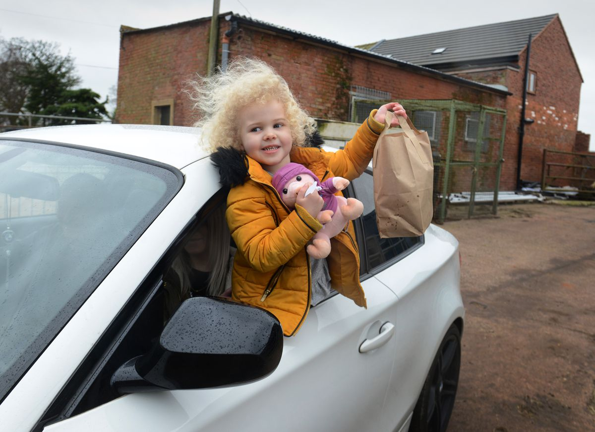 Sasha-Lea Cartright, of Stafford, with her food looking at the farm animals