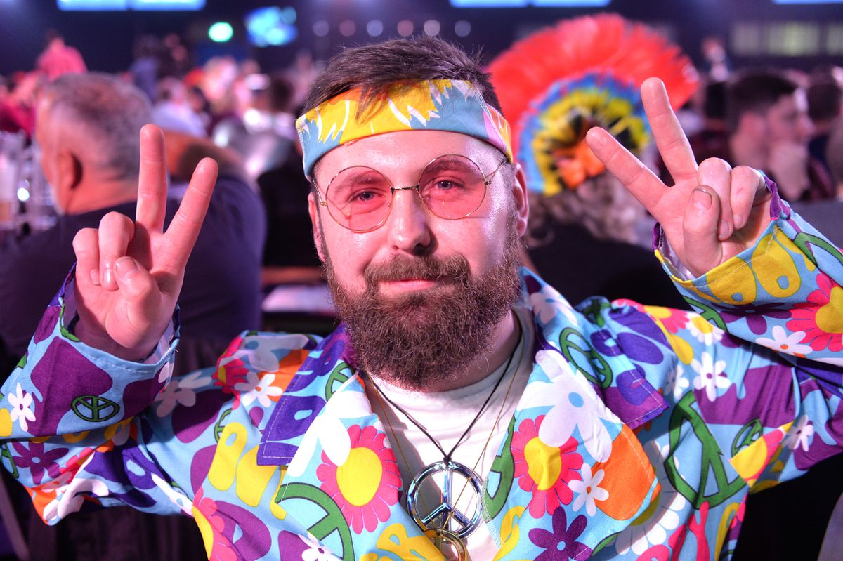 Sam Micklewright dressed up in a disco-themed outfit.