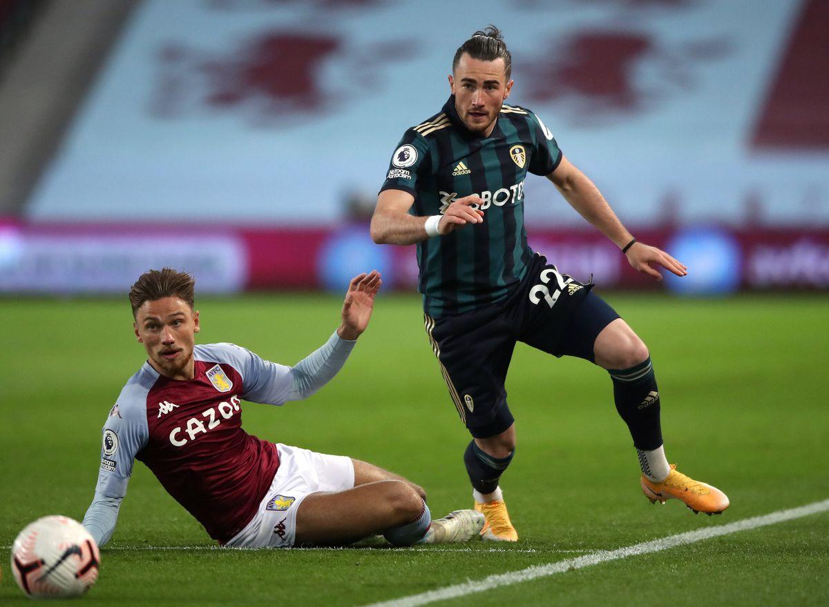 Leeds United's Jack Harrison (right) and Aston Villa's Matty Cash