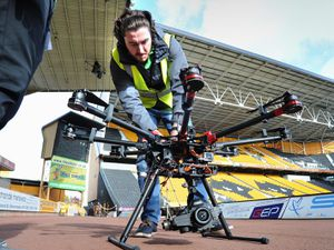 Mike Chinn at work, filming footage at Molineux