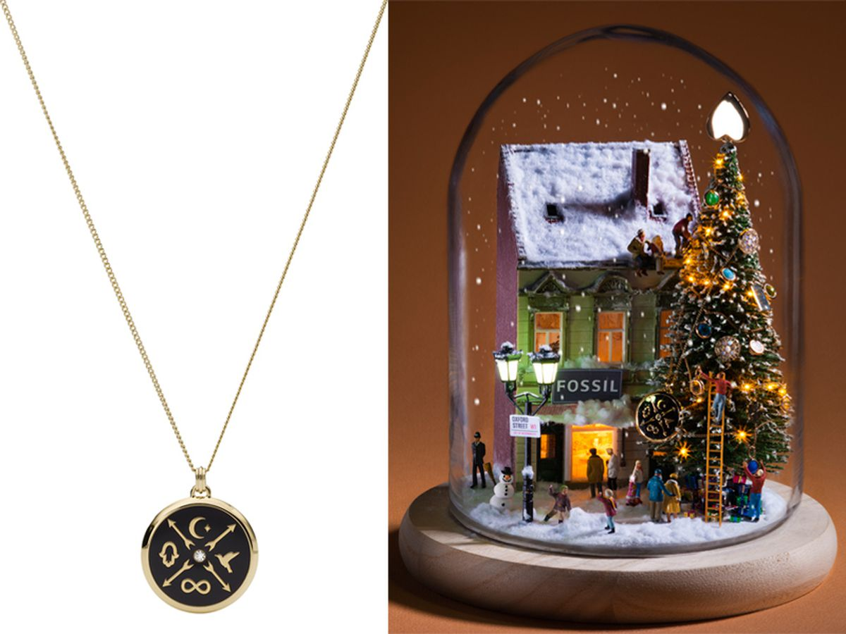 Left, the Little Fortunes Black Stainless Steel Pendant Necklace, and right, the necklace in the Fossil and Minimiam holiday snow globe scene