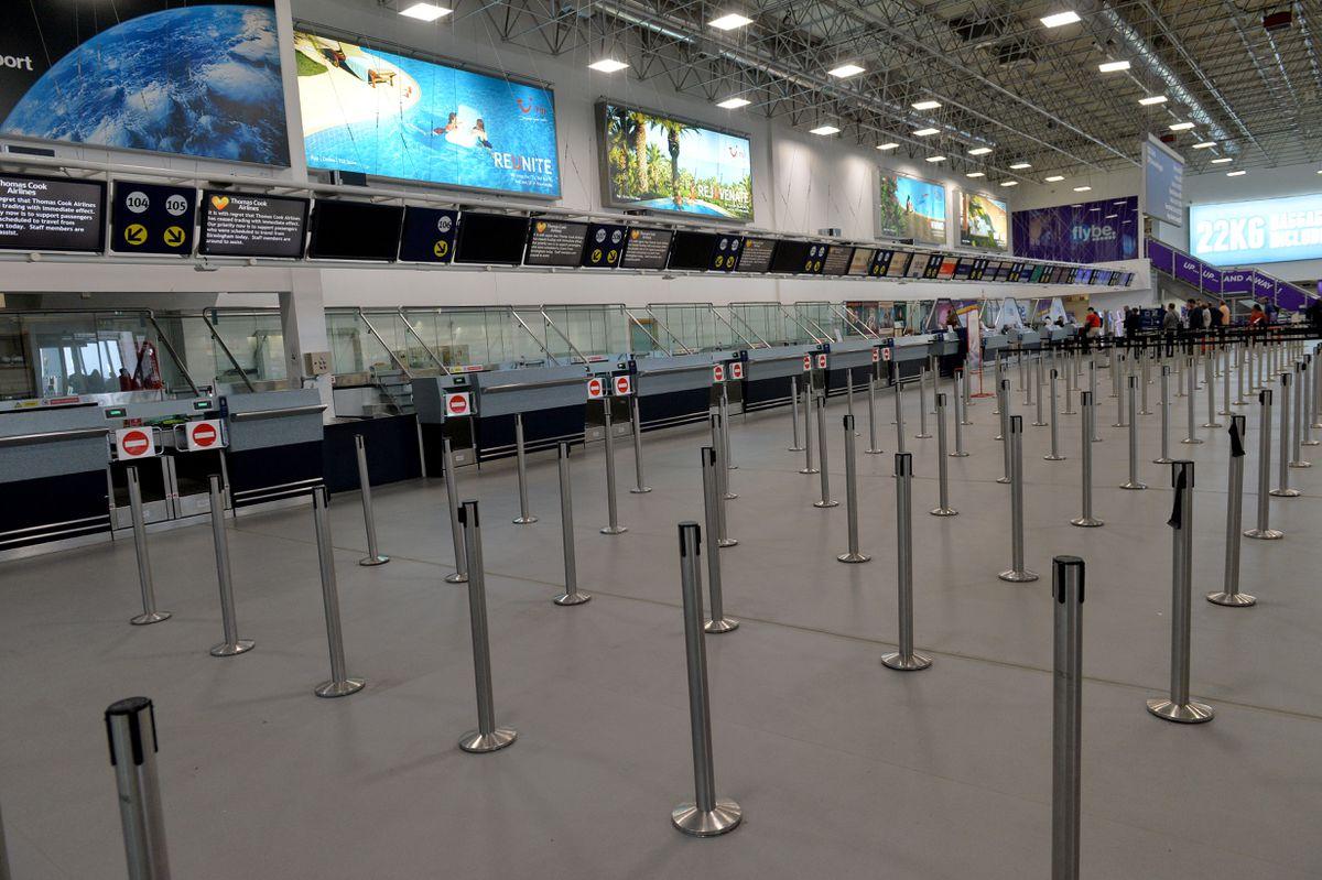 Empty Thomas Cook desks at Birmingham Airport