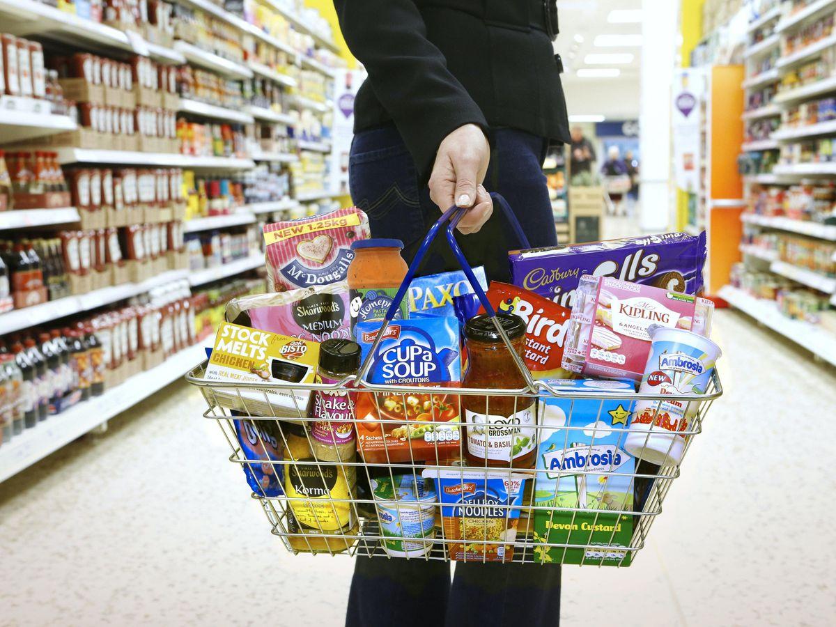 A supermarket basket full of Premier Foods products