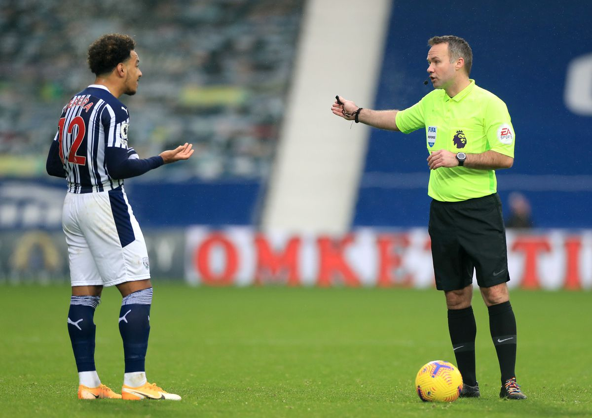 Referee Paul Tierney (right) sends off West Bromwich Albion's Matheus Pereira during the Premier League match at The Hawthorns,