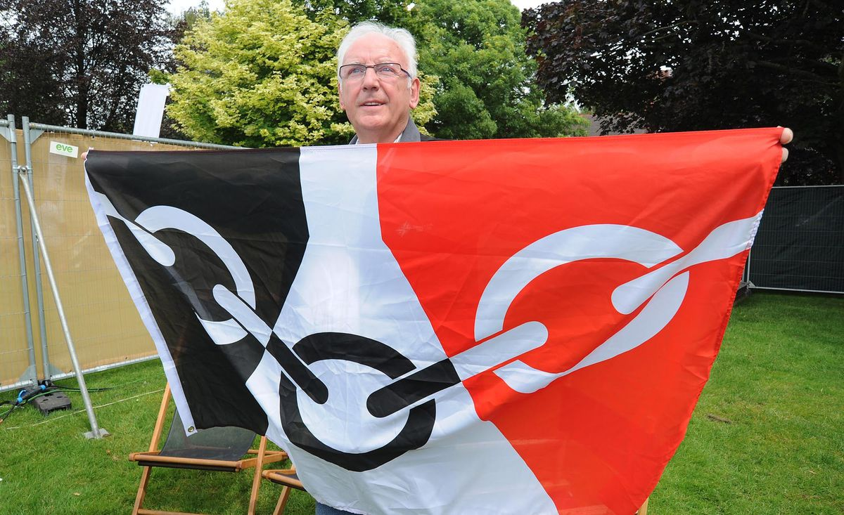 Pete Waterman with the Black Country flag