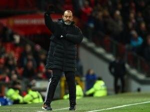 Wolverhampton Wanderers manager / head coach Nuno Espirito Santo waves to the travelling fans.