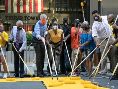 NY mayor helps paint Black Lives Matter in front of Trump Tower