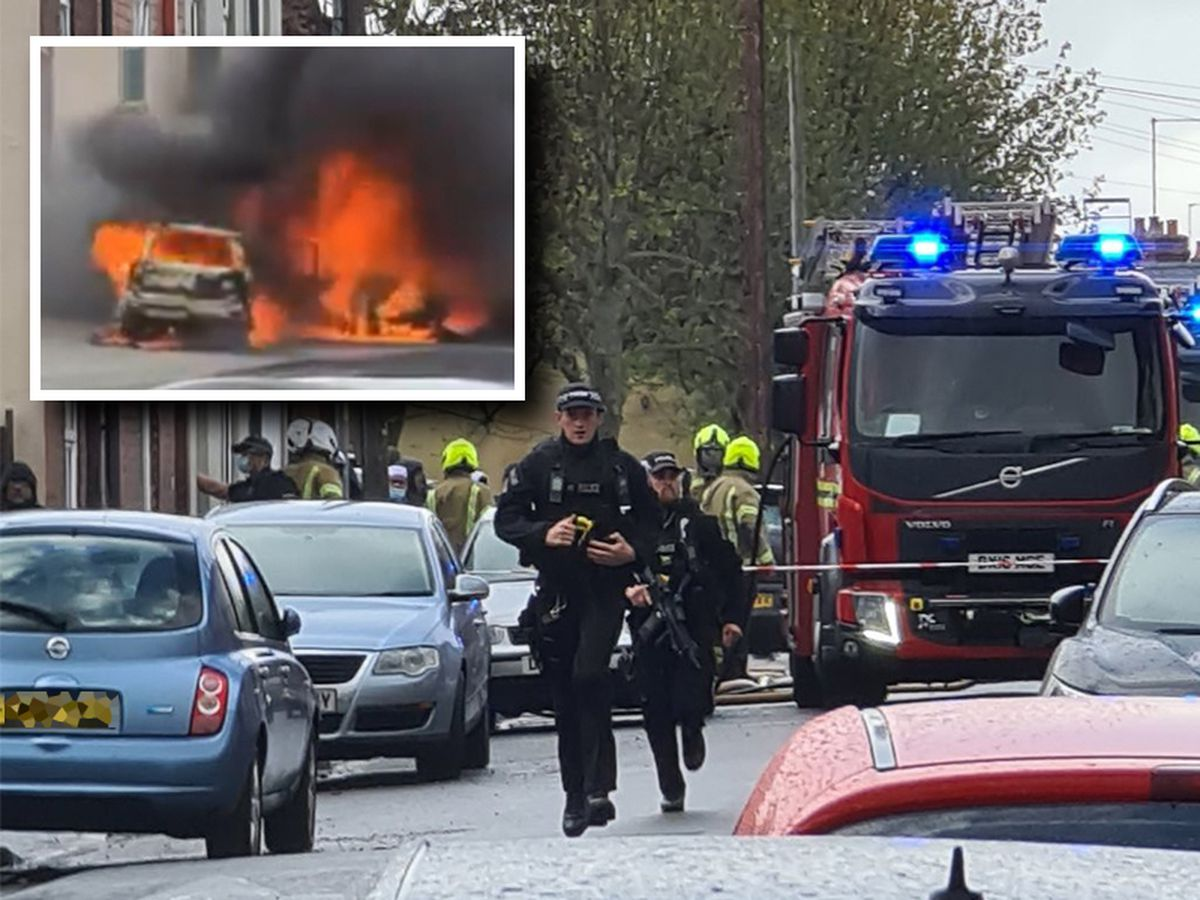 Armed police at the scene where cars caught fire. Photos: Matt Higgins/Your Walsall