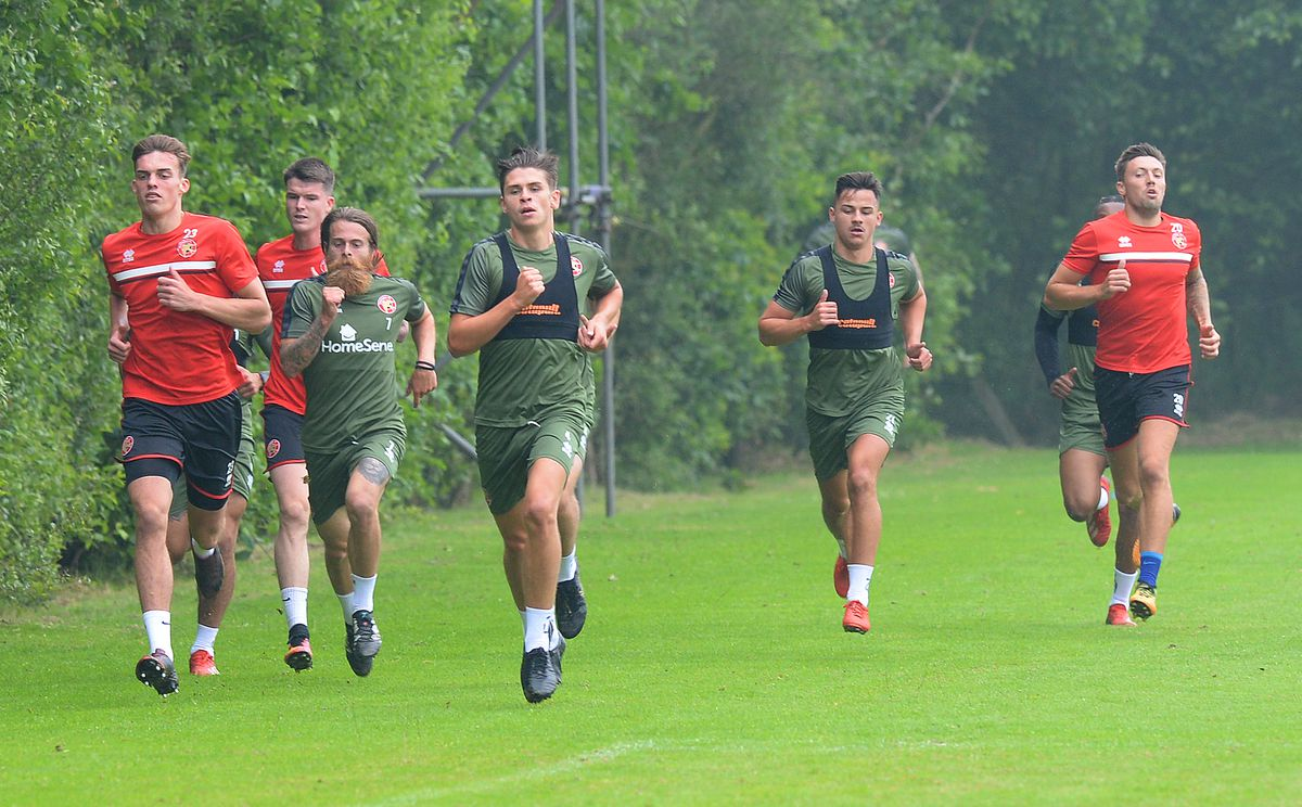 Liam McAlinden (second left) and Jon Flatt (far right) are training with Walsall.