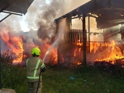 Firefighters tackle blazing buildings at Aldridge farm