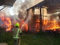 Firefighters tackle blazing buildings at Aldridge farm
