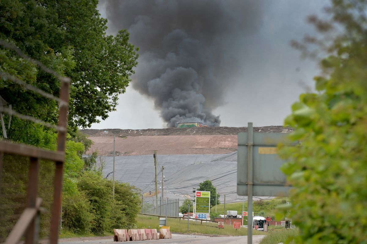 Thick plumes of smoke can be seen filling the sky