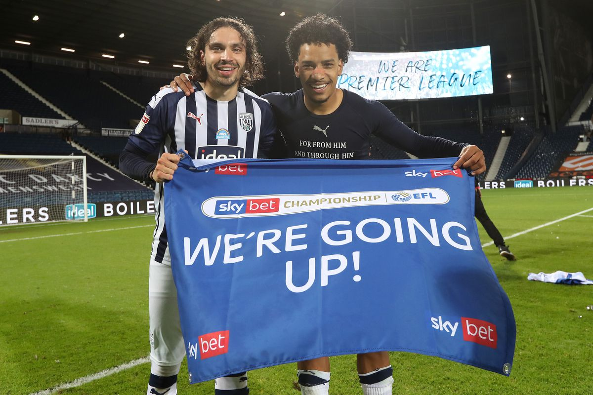 Filip Krovinovic of West Bromwich Albion and Matheus Pereira of West Bromwich Albion as they celebrate promotion to the Premier League on the pitch at the end of the match. (AMA)